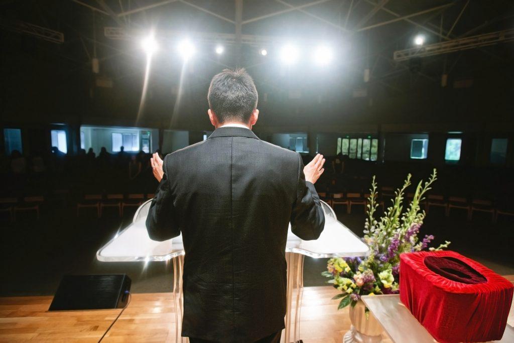 Pastor praying for congregation