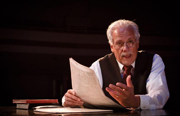 Chuck Neighbors as Henry Maxwell talks about the Raymond Daily News